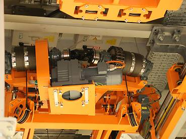 Orange dual-track electrified monorail system with lifting drive and rope drum