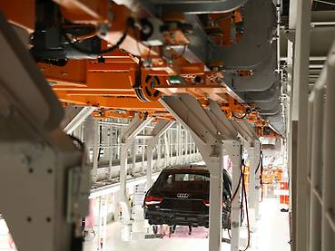 Audi A1 in an orange-painted carrier of the electrified monorail system