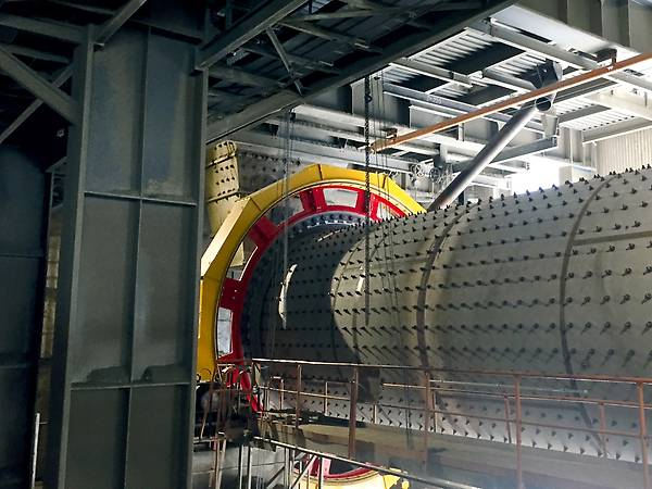 Ball mill with red girth gear and yellow protection cover