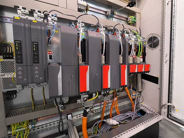 Control cabinet with inverters and PES modules