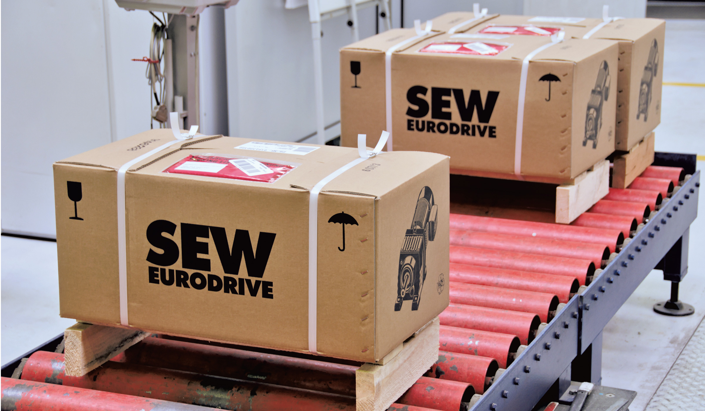 Two shipping packages from SEW‑EURODRIVE in the outgoing goods area