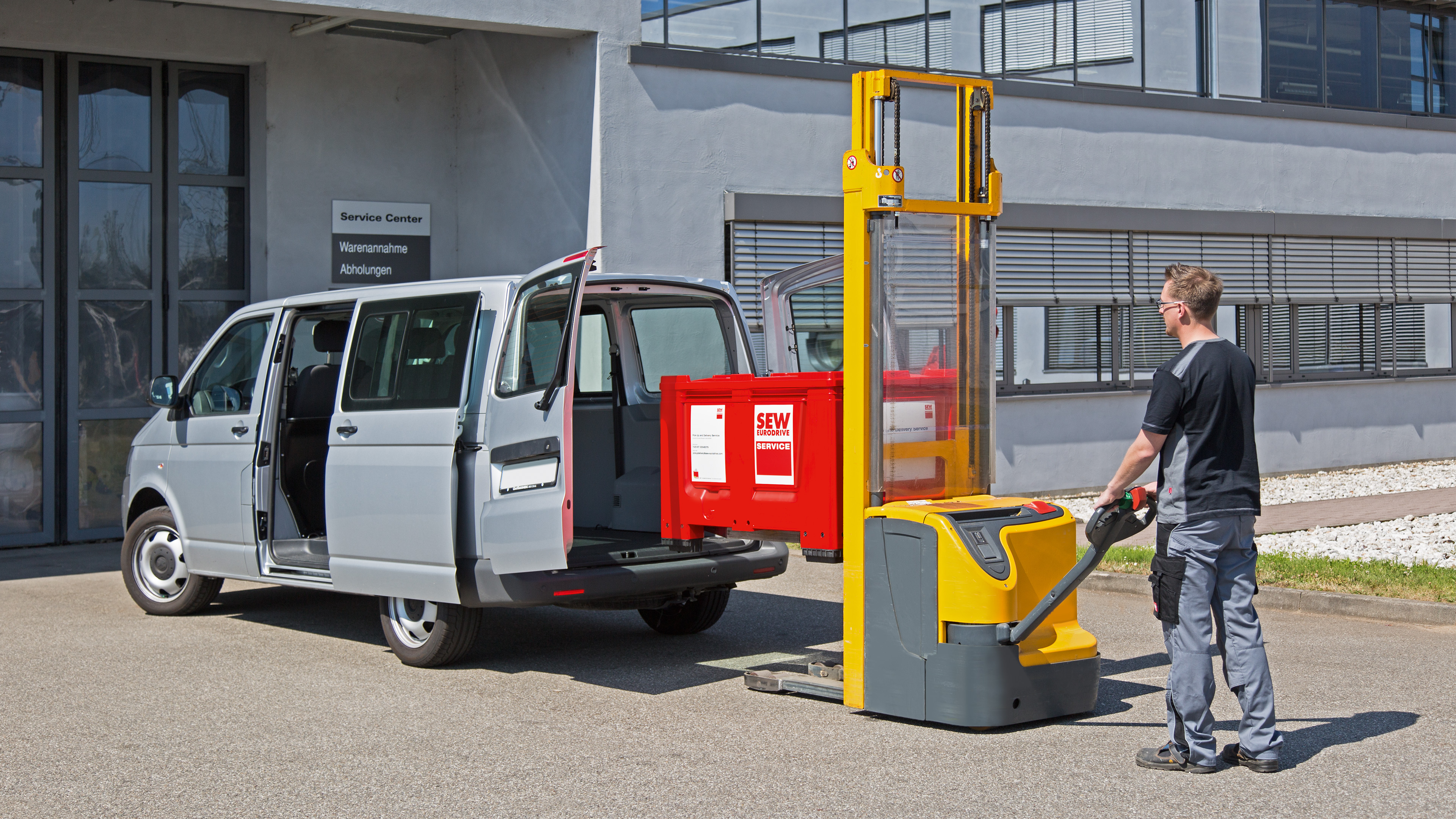 SEW-EURODRIVE employee loading a Pick-Up Box